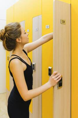 Woman looking through locker