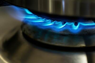 Lit gas stove with blue flame
