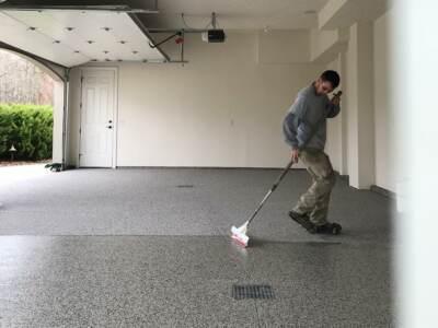 Contractor Installing Epoxy Flooring