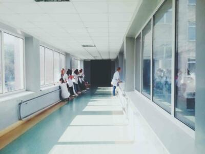 Doctors standing by windows in a long hospital hallway | Epoxy flooring applications