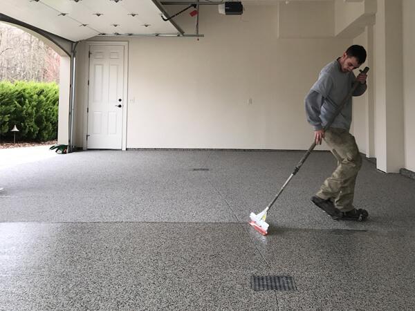 OGI contractor installing epoxy floor coating   Northeast Ohio Flooring Companies
