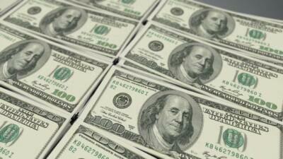 Stacks of 100-dollar bills | Natural stone flooring costs