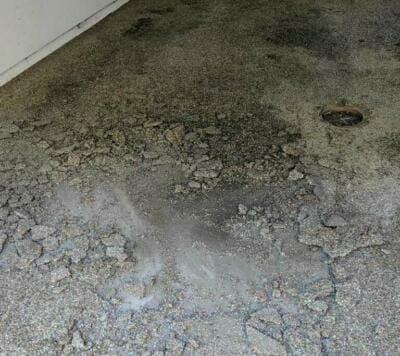 A severely damaged garage floor   Garage floor repair services
