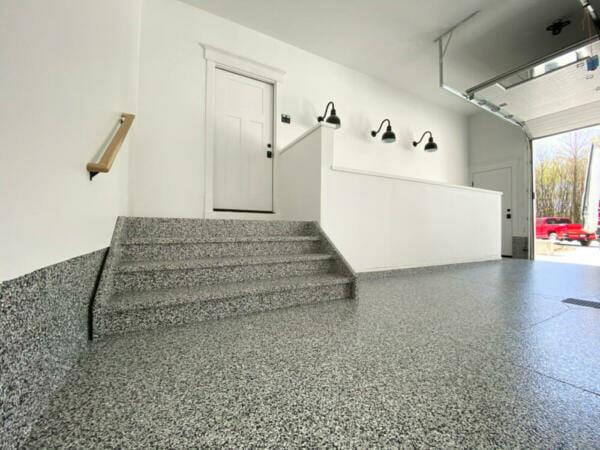 A grey polyaspartic floor installed by OGI   Polyaspartic vs. Epoxy