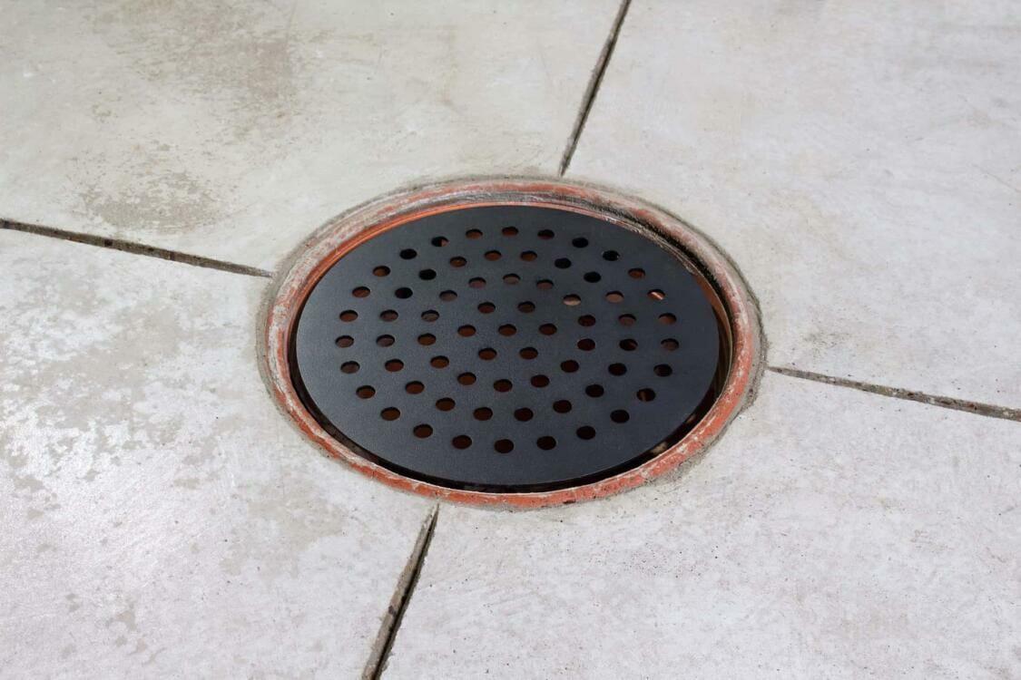Black steel garage drain cover