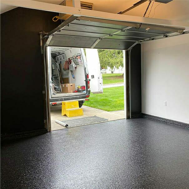 View of OGI van from garage interior | Low epoxy floor cost